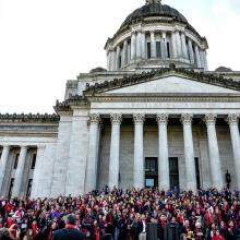 Washington State Capitol Building with activist crowd